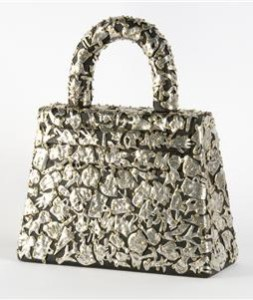 Female Fetish: Purse, pewter and brass on wood