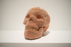 Skull (copper), 2013, air rifle BBs, cast resin, mixed media, 6 x 6 x 8 in.