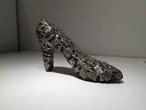 Female Fetish: Shoe, 2004, pewter and brass on wood, 9 x 6 x 3 in.