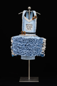 Master of Her Fate, 2017,  astrology and astronomy books, vintage buttons, ribbon, gel medium, acrylic spray, steel stand, 24 x 12 x 12 inches