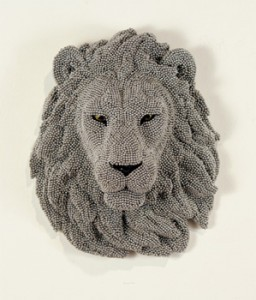 Urban Herd: Lion, 2012 cast resin, air rifle BBs, mixed media 16 x 13 x 8 inches