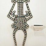 Bipolar, 2011, magnet, compasses, chair parts, 51 x 19 in.
